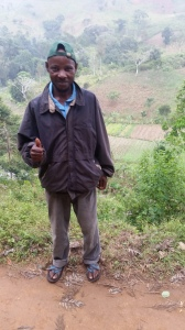 Project Partner and Organic Coordinator Mngoma, whose farm plot is in the valley behind him